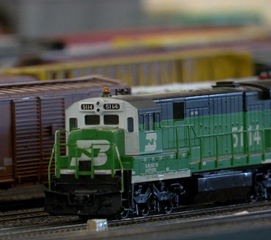 Green model train engine on a track