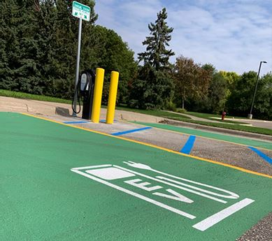 Electric vehicle charging station and green painted parking space