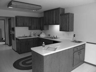 Grey kitchen with U shape conter top