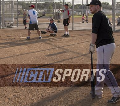 Adult softball league playing at Sand Creek Park
