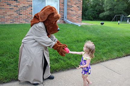 Girl plays ball with McGruff