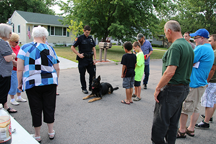 Officer and his k-9 teaching a crowd in the street